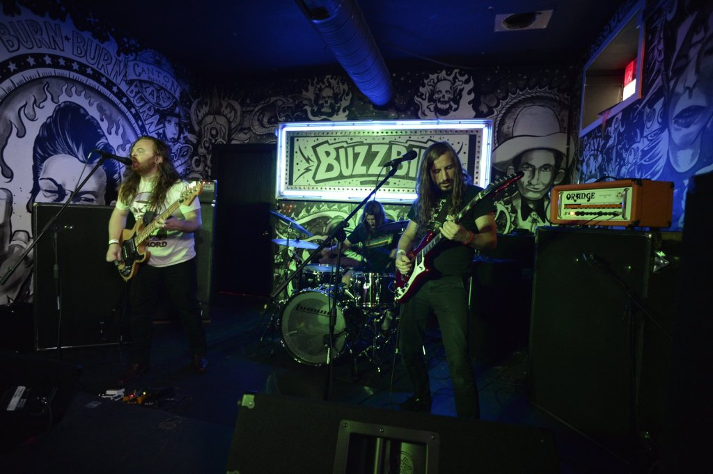 Band members performing on stage.